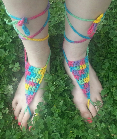 http://lizardbreath.storenvy.com/products/5586712-barefoot-sandals-multicolor