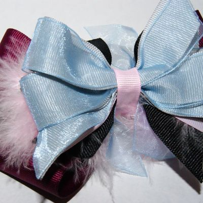 Deep burgundy, pink, pale blue with a little fluffy boutique hair bow