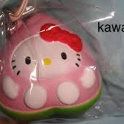 *rare* hello kitty in a peach squishy