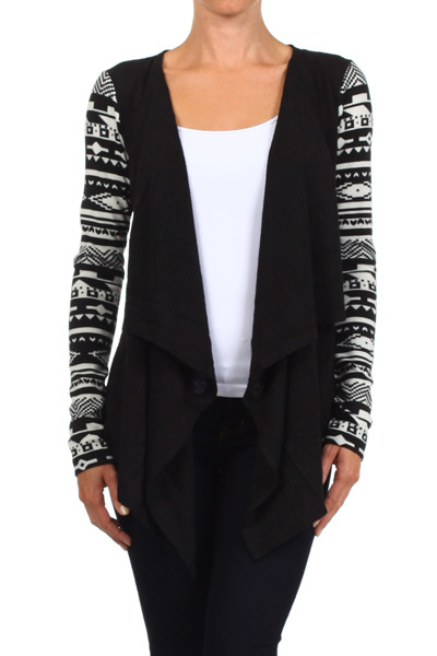 Black and white aztec lightweight printed open front cardigan with slight fringe detailing along the front opening. Great with a pop of color for a bold statement, or pair with a white .