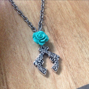 Crossed Guns with Rose Necklace