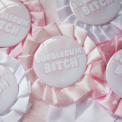 """bubblegum bitch"" rosette pin"